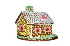 Het broodhuis van de gember voor Kerstmis die op wit wordt geïsoleerda Stock Foto's