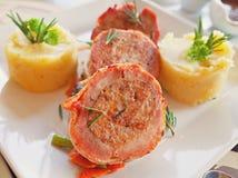 Het broodje van het varkensvleeslapje vlees stock afbeelding