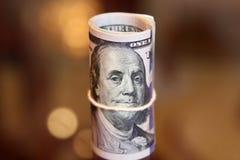 Het broodjesgeld van dollarrekeningen Stock Foto