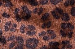 Het bruine patroon van het luipaardbont als achtergrond royalty-vrije stock afbeeldingen
