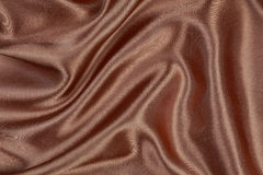 Het bruine van het het satijnfluweel van de zijdetextuur materiële of elegante behang DE Stock Afbeelding