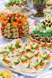 Het buffetstijl van de catering - tomaten, mushroomes en o Stock Foto's