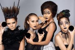Het buitensporige Creatieve Talent maakt omhoog en Haarstijl op Vier Aziatische Beaut royalty-vrije stock foto