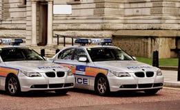 Het bureau van de politie, raad, auto's. stock afbeeldingen