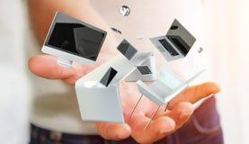Het bureaulaptop van de zakenmanholding vliegende telefoon en tablet in zijn h Stock Foto