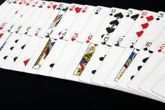 Het casino van de speelkaartenpook op de zwarte achtergrond van de pooklijst Royalty-vrije Stock Afbeeldingen