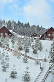 Het chalet van de de winterski, sneeuwlandschap, de winterachtergrond met exemplaarruimte royalty-vrije stock foto