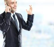 Het charmante zakenman telefoneren stock foto's