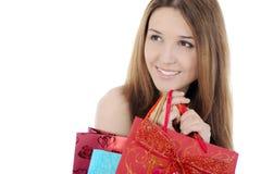 Het charmeren brunette met een het winkelen zak Stock Foto's