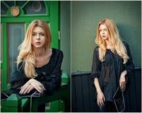 Het charmeren van jonge blondevrouw in het zwarte blouse stellen voor een groen geschilderd deurkader Stock Foto's