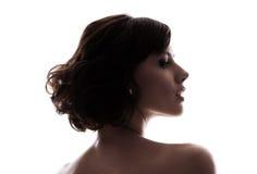 Het charmeren van jonge vrouw over witte achtergrond stock fotografie