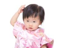 Het Chinese gevoel van het babymeisje verwart stock afbeeldingen