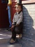 Het Chinese jongen spelen Stock Afbeeldingen