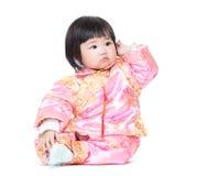 Het Chinese krassende haar van het babymeisje stock foto