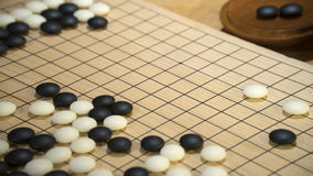 Het Chinese raadsspel gaat of Weiqi met exemplaarruimte voor titel royalty-vrije stock foto