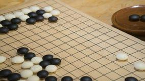 Het Chinese raadsspel gaat of Weiqi met exemplaarruimte voor titel stock foto's