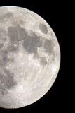Het close-up van de Maan op een zwarte die nachthemel door een telescoop is ontsproten Stock Foto's