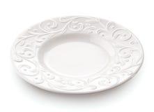 Het close-up van de porseleinplaat op witte achtergrond wordt geïsoleerd die Royalty-vrije Stock Afbeelding
