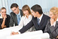 Het commerciële team werken Stock Afbeeldingen