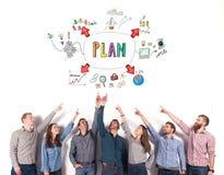 Het commerciële team wijst op een bedrijfsproject concept creatief idee en groepswerk royalty-vrije stock afbeelding