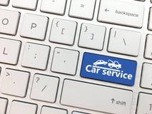 Het computertoetsenbord gaat knoop met de Autodienst en symbool in royalty-vrije stock fotografie
