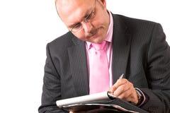 Het concentreren zich op zijn nota's stock afbeeldingen