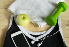 Het concept een gezonde levensstijl Apple, domoor, handdoek, t-shirt Stock Fotografie