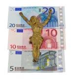 Het concept gouden Jesus kruisigt euro geïsoleerdee bankbiljetten Royalty-vrije Stock Foto