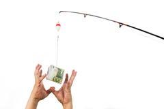 Het concept handen die voor geld bereiken casted als aas bij de visserij van Li Stock Afbeeldingen