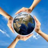 Het concept het beschermen van de wereld. Stock Foto's