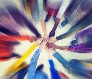 Het Concept van Clasped van groeps Mensen Handen Stock Afbeeldingen