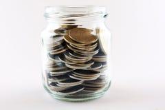 Het concept van de besparing met een geldstorting Stock Fotografie