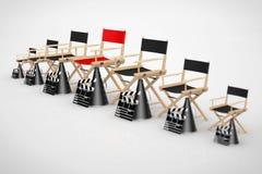 Het Concept van de bioskoopindustrie Directeur Chairs, Filmkleppen en Meg Stock Afbeeldingen