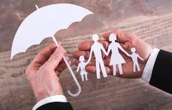 Het concept van de familieverzekering Stock Foto's