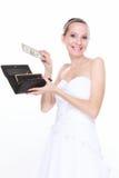 Het concept van de huwelijksuitgave. Bruid met beurs en één dollar Stock Foto's