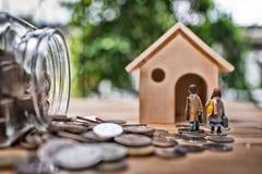 Het concept van de hypotheek Geld en huis Royalty-vrije Stock Foto's