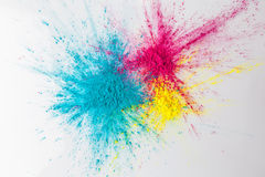 Het concept van de kleurenexplosie met holipoeder stock foto
