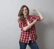 Het concept van de meisjesmacht, vrouwelijke spieren, Stock Afbeeldingen
