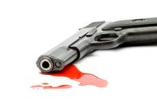 Het concept van de moord - kanon en bloed stock afbeelding