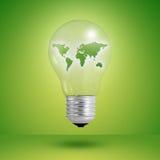Het concept van Eco: gloeilampen met binnen kaart van wereld Stock Foto's