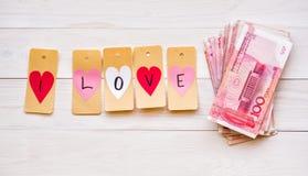 Het concept van het geld pak van Chinese munt op witte rustieke achtergrond Stock Foto's