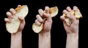 Het concept van het dieet. De hand verfrommelt een boterham. Royalty-vrije Stock Afbeeldingen