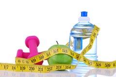 Het concept van het het gewichtsverlies van het dieet met meetlint stock foto