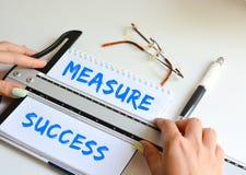 Het concept van het maatregelensucces in een bedrijf stock foto