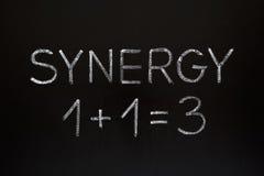 Het Concept van het synergisme op Bord Royalty-vrije Stock Foto's