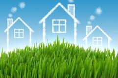 Het concept van onroerende goederen met huizen Stock Fotografie