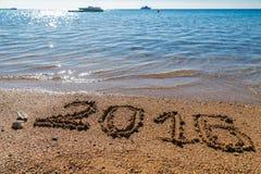 het concept van 2016 op het overzeese strand Stock Foto