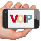 Het concept van het Webontwerp: Handholding Smartphone met VOIP op vertoning Royalty-vrije Stock Foto's