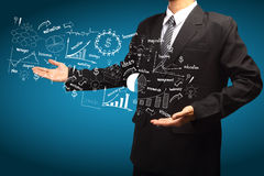 Het conceptenidee tekenings van het bedrijfsstrategieplan in de handen Royalty-vrije Stock Afbeelding