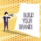 Het conceptuele hand het schrijven tonen bouwt Uw Merk De bedrijfsfototekst leidt of verbetert klanten tot kennis en royalty-vrije illustratie